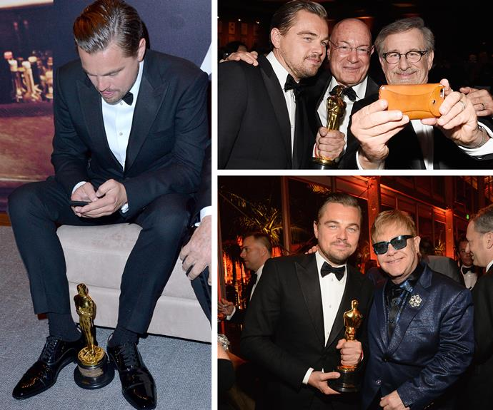 Man of the moment: Selfies with Steven Spielberg and Elton John... not bad for a first-time Oscar winner. We'd love to know who Leo was texting!