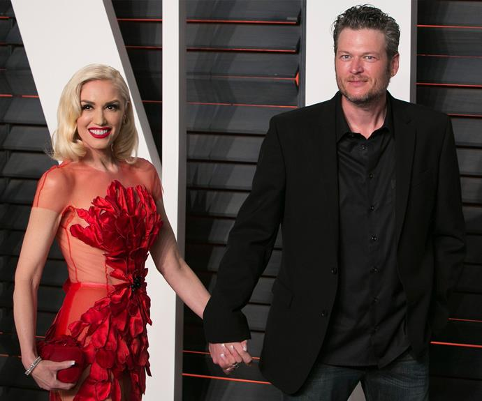 Say cheese! Gwen Stefani can't stop smiling as she makes her red carpet debut with her new man. Holding on tight, her boyfriend, Blake Shelton.