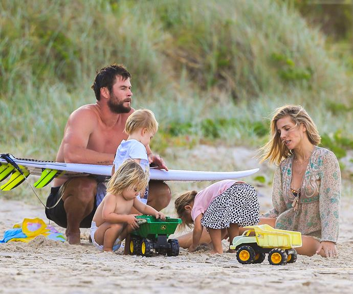 Elsa and Chris watched on contently as their kids played in the sand.