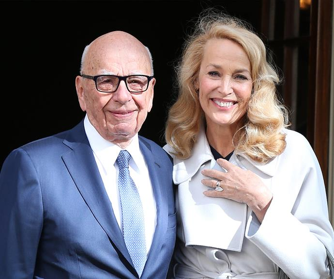 The blushing bride and Rupert Murdoch beam with happiness on their wedding day.