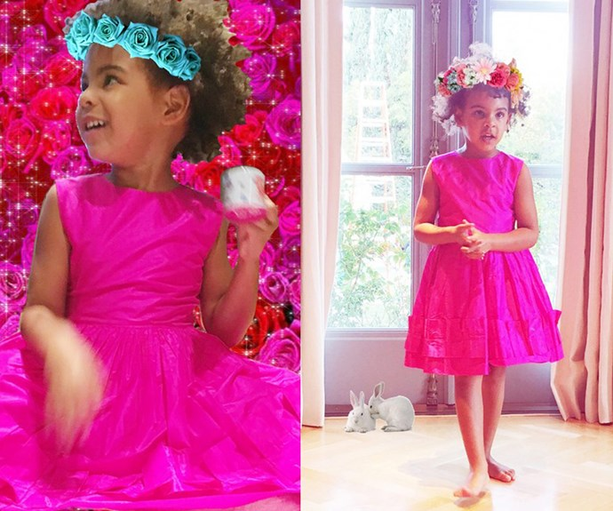 The four-year-old looked adorable in a pink dress and flower crown.