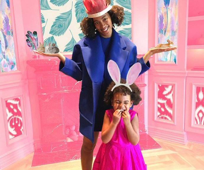 Blue Ivy Carter and her aunt Solange Knowles get into the Easter spirit with a mad hatters-inspired tea party.