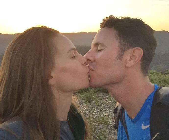 Sealed with a kiss: Hilary happily said yes.