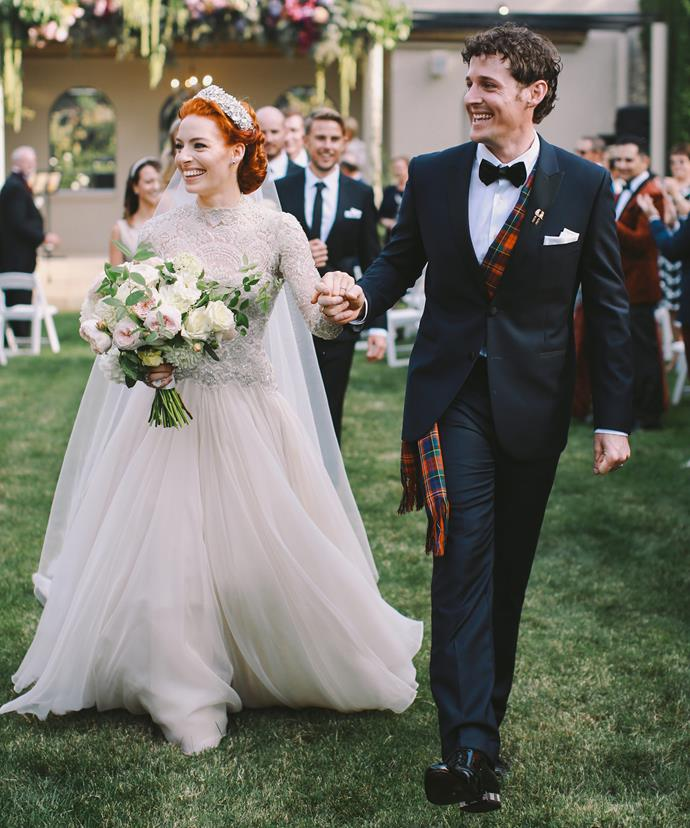 Simply stunning! Emma wore a vintage princess gown while Lachy looked dapper in a classic suit.