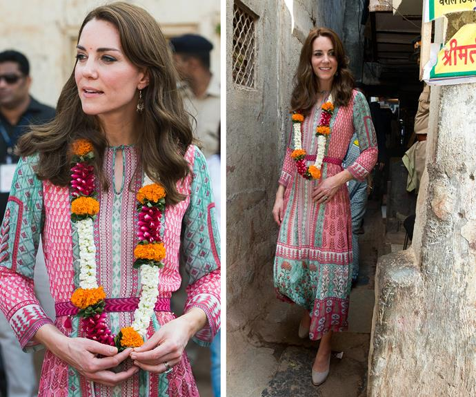 The brunette beauty made a nod to the vibrant nation donning a flowing, printed dress by Mumbai designer Anita Dongre.
