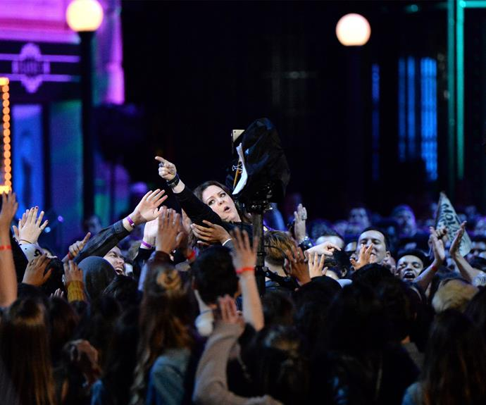Melissa McCarthy was honored as the first woman to ever win the *Comedic Genius Award*. The 45-year-old made her way to the stage in the most epic way possible... crowdsurfing across the audience!