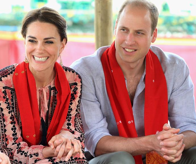 Wills and Kate were presented with handmade red scarves.