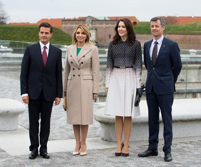 Donning a chic ombre coat, the brunette beauty stood with her handsome beau, Frederik, Crown Prince of Denmark as they welcomed the couple.