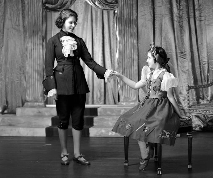 Who doesn't love a bit of pomp and theatre? When she just a teenager, Princess Elizabeth loved to participate in numerous pantomimes during the Second World War. Here she is at the age of 15 in a rare image of her playing the part of Prince Florizel alongside her sister Margaret in Cinderella back in 1941.