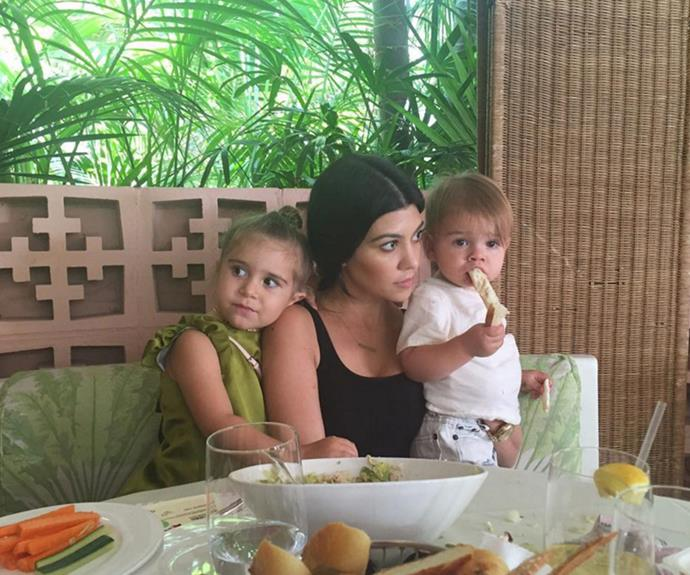 Kourtney with her daughter Penelope and her youngest, Reign.