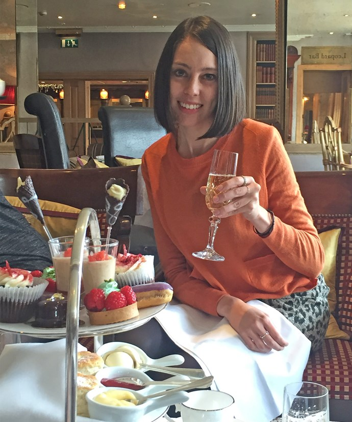 Cheers! *Woman's Day's* Foreign Editor Erin enjoys some bubbles with her traditional English afternoon tea.