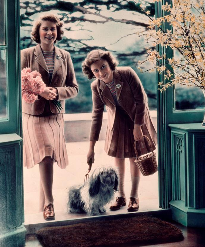 The Monarch has long loved dogs and over the course of her life, has had countless treasured pets. Here Queen Elizabeth (L) and her sister, Princess Margaret, pose with a pup back in 1942.