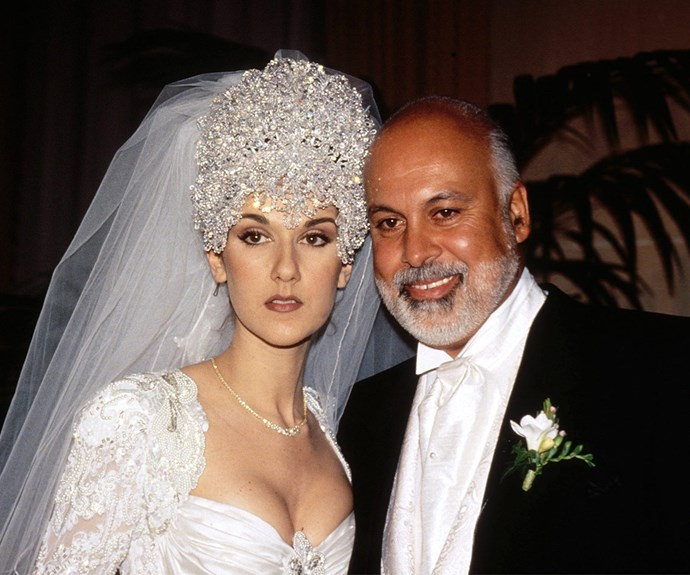 """She's a performer at heart and on her 1994 wedding day to René Angélil, Celine Dion made sure all eyes were on her in this bold creation by Mirella and Steve Gentile. In a love story for the ages, the couple remained together until [Rene's tragic death in January, 2016.](http://www.nowtolove.com.au/celebrity/celeb-news/celine-dions-heartbreaking-last-words-to-her-husband-28532