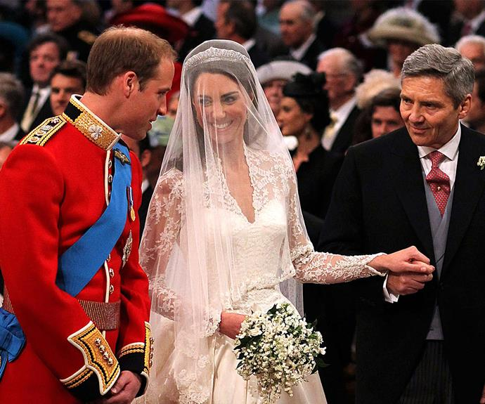 William was speechless to see his beautiful bride! Here, Kate flashes him an excited smile as her father gives her away.