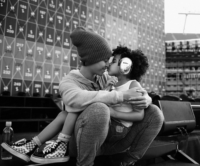 Blue and Bey share a back-stage smooch ahead of the singer's *Formation* world tour. **Watch the cute duo in the next slide. Gallery continues after...**