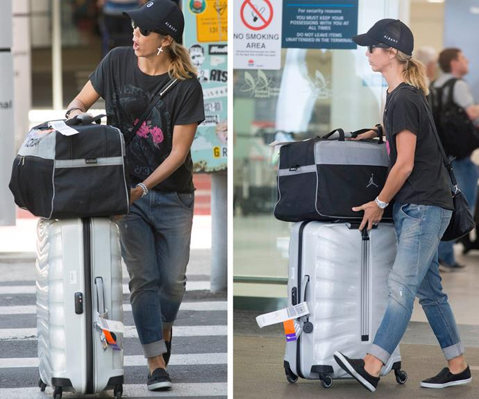 Come on! The former-actress is showing her multiple bags of luggage who's boss!