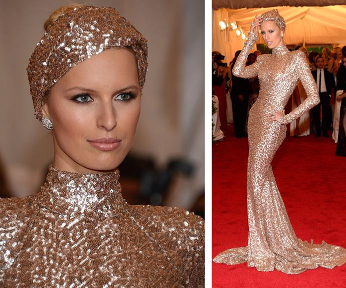 In 2012, model Karolina Kurkova hit the red carpet channeling C-3PO in this bedazzled gold Rachel Zoe gown, which she topped off with a matching turban.