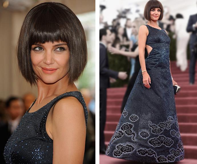 Katie Holmes seemed to float on by in a midnight, sparkly backless Zac Posen gown, topped off by a chic bob.