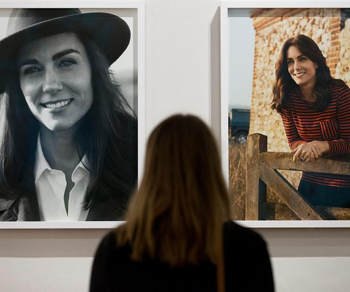 An onlooker gazes up at the stunning portraits at the *Vogue 100: A Century of Style* exhibition at the National Portrait Gallery in London.