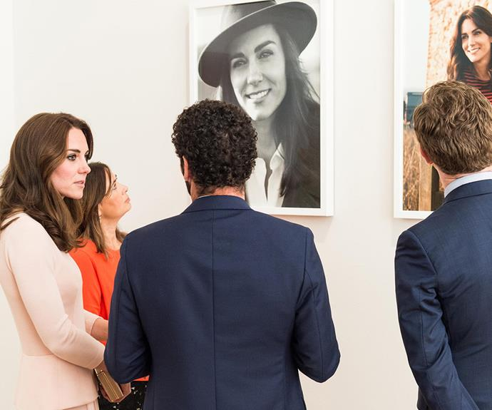 Hey, that's me! Catherine chatted to onlookers as her stunning *Vogue* portraits stole the show.