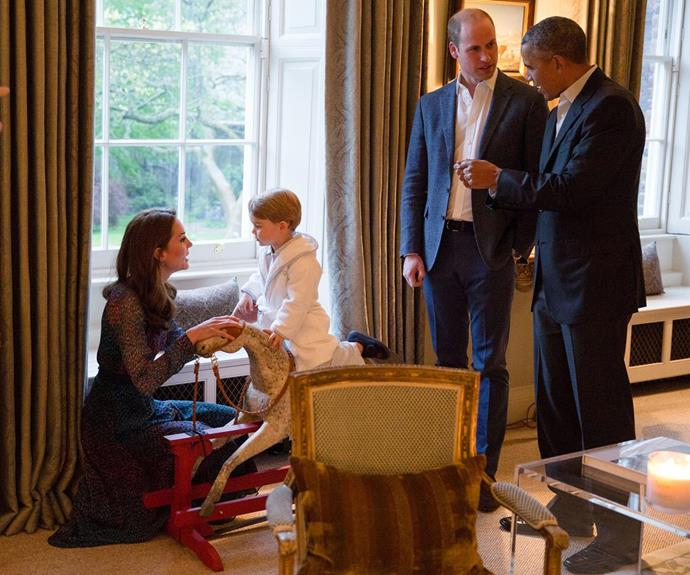 George showed off his rocking horse skills as Duchess Catherine proudly clapped him on. The toy was given to George from The Obamas when he was born.