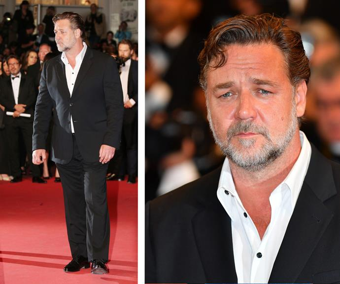 Russell Crowe rocked a more casual look with a buttoned down, open shirt under his black suit.