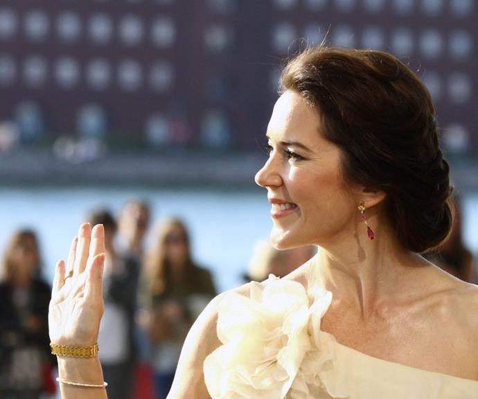 Ever the thrifty Princess, Mary donned a repeat frock. The pretty brunette wore the same cream coloured, tiered gown back in 2009 on a state visit to Vietnam.