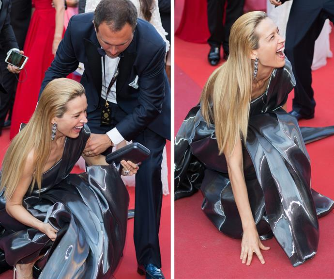 Czech supermodel Petra Nemcova took a mighty tumble on the Cannes red carpet but judging by the grin on her face, it didn't phase her too much.