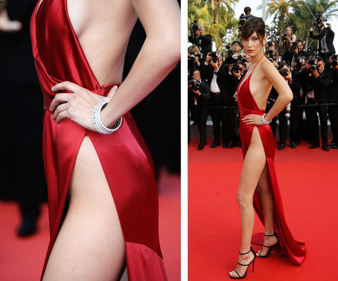 Fresh from walking the runway at Sydney Fashion Week, Bella Hadid took on the Cannes red carpet in a gravity-defying, silky red number. Ditching any under garments, the leggy lady certainly was brave! **Watch the model strut her stuff in the next slide!**
