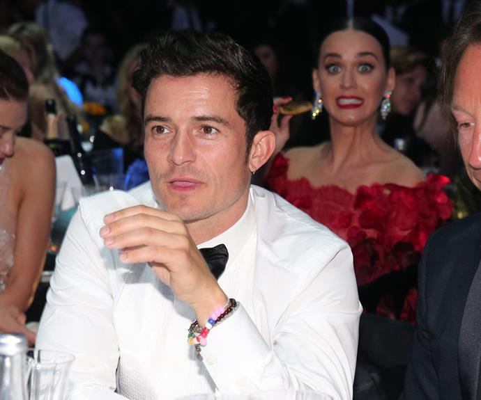 On Thursday, both Orlando and Katy attended the amfAR's 23rd Cinema Against AIDS Gala. Although they we seated on separate tables, the kooky singer couldn't help but photobomb her beau.