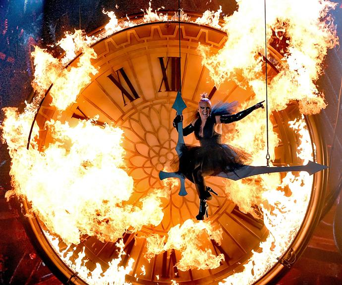 And she is LITERALLY on fire as she performs the theme song for the new Alice in Wonderland sequel.
