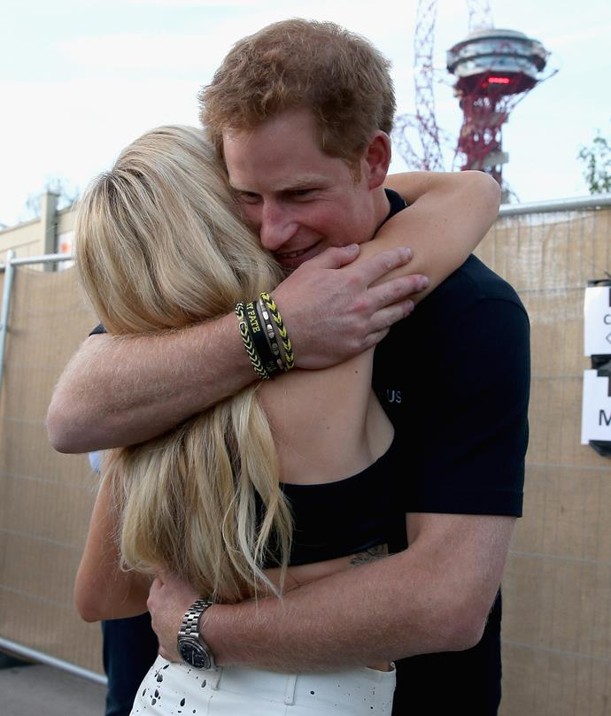 Harry and Ellie share a hug at the 2014 Invictus Games.