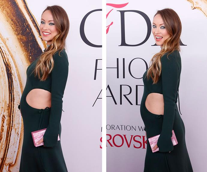 Olivia Wilde showed off her burgeoning bump in a skintight, cutout moss green dress by Rosie Assoulin at the 2016 CFDA Fashion Awards on Monday in New York.