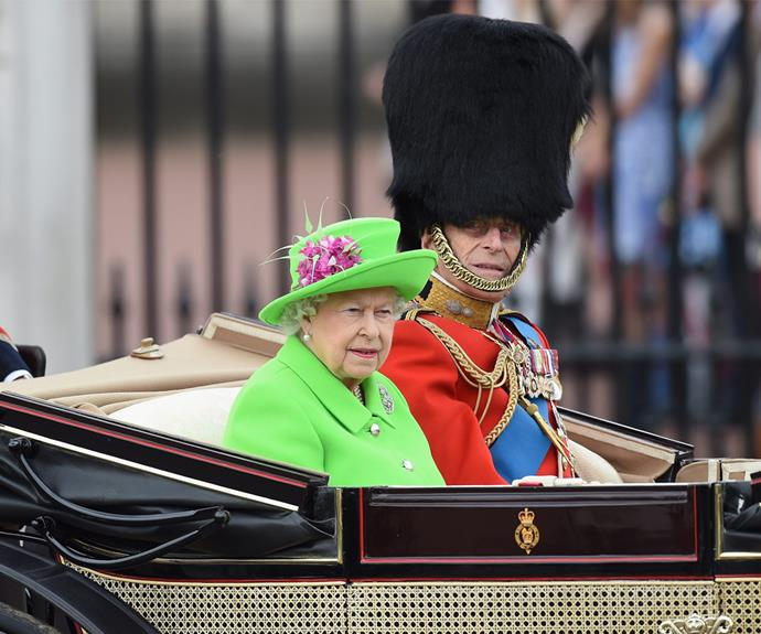 Queen Elizabeth II arrives at the Trooping the Colour celebration, with Prince Philip by her side.