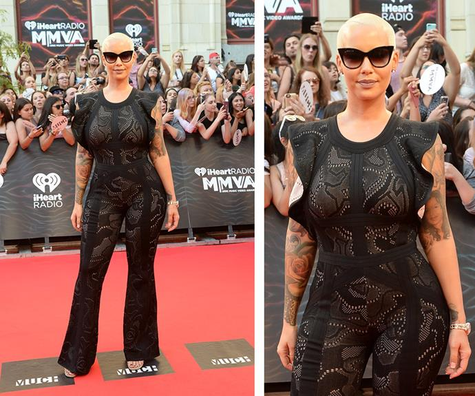 The infamous Amber Rose showed off her Kardashian kurves in a skintight, lace jumpsuit.