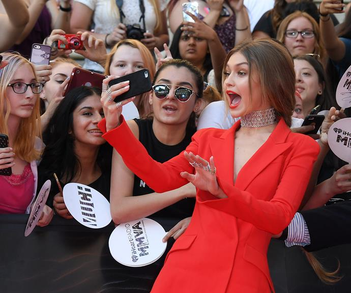 Hostess with the mostess, Gigi Hadid, set the tone for the celebrations, taking selfies with fans on the red carpet in an equally red suit.