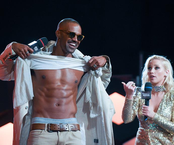 Former *Criminal Minds* star Shemar Moore put on a muscly display as he presented an award.