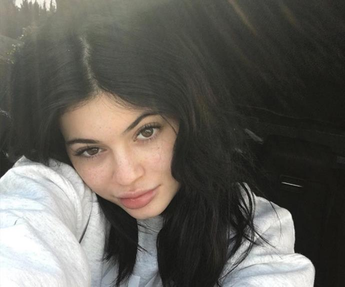 "She's usually all glammed up, but in a rare makeup-free moment, Kylie Jenner showed off her enviable skin. ""Saw someone comment why I don't embrace my freckles anymore. So here's a freckle appreciation post,"" she captioned."