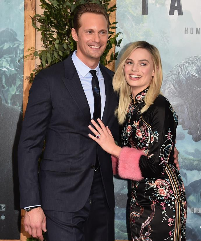 """Can everyone see my ring?"" Margot makes sure that even when she's standing with her co-star Alexander Skarsgard, that the rock is on display."