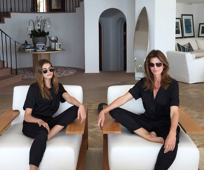 Twinning! Cindy and Kaia chill in their Coco Rocha designed jumpsuits.