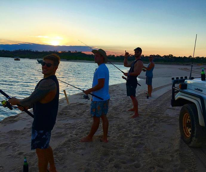 """Chris takes a moment to fish with the locals of The Kimberly in Western Australia. """"A little sunset fish with the boys, get me back there!!"""" he wrote."""