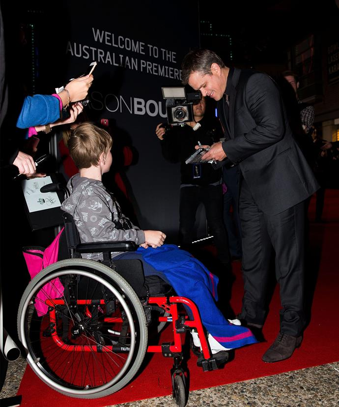 This young child in a wheelchair was beside himself at getting an autograph from his idol!