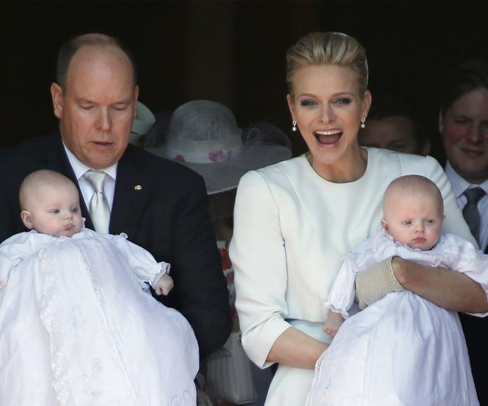 The pretty blonde can't hide her glee at the kid's christening.