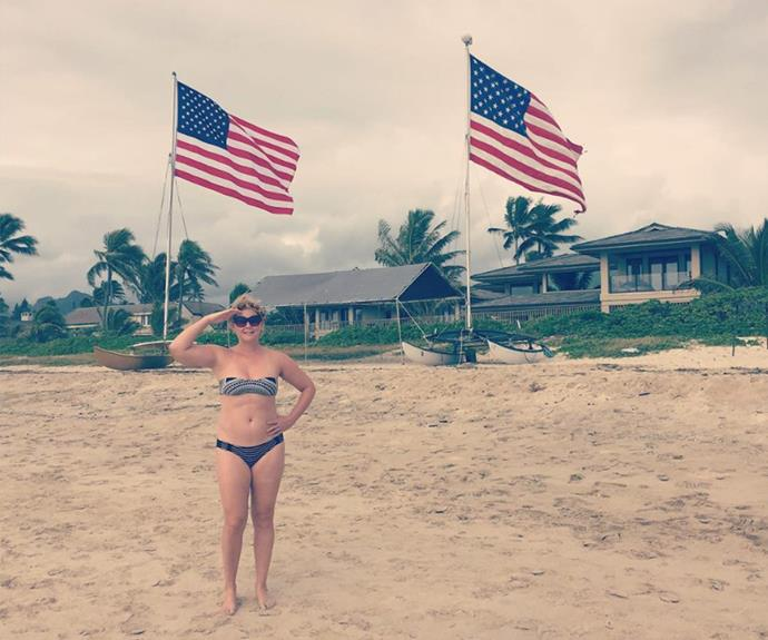 Comedienne Amy Schumer struck a pose between two American flags for the occasion.