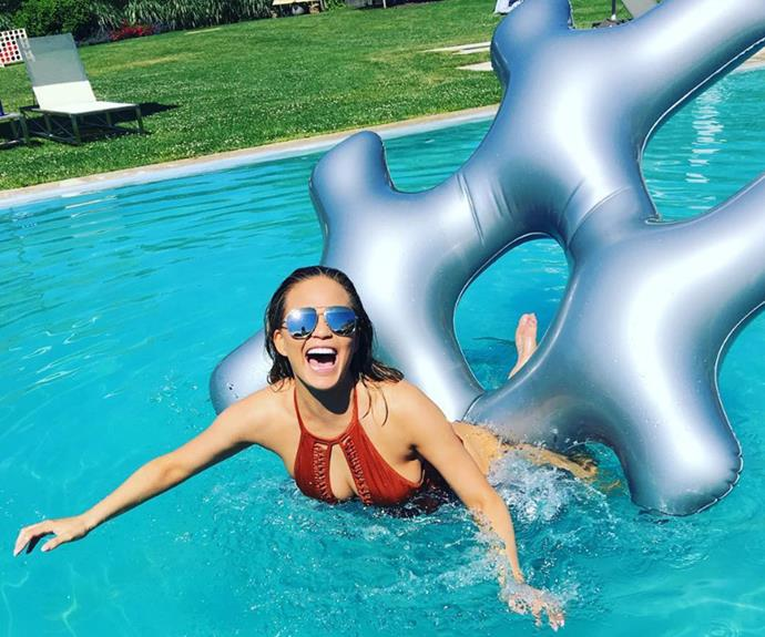 Chrissy Teigen had plenty of fun in the pool hosting a barbecue for the weekend.