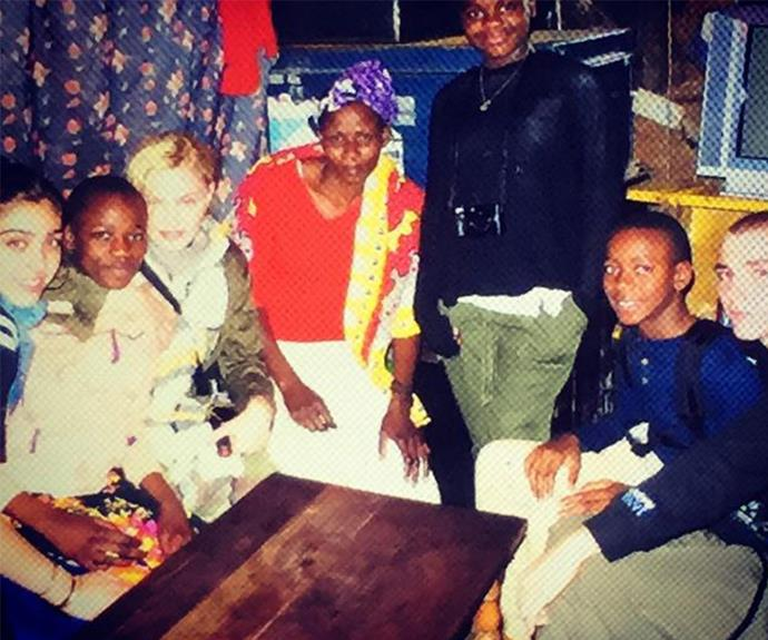 Madonna posed with all her children during a visit with locals in Africa on Monday.