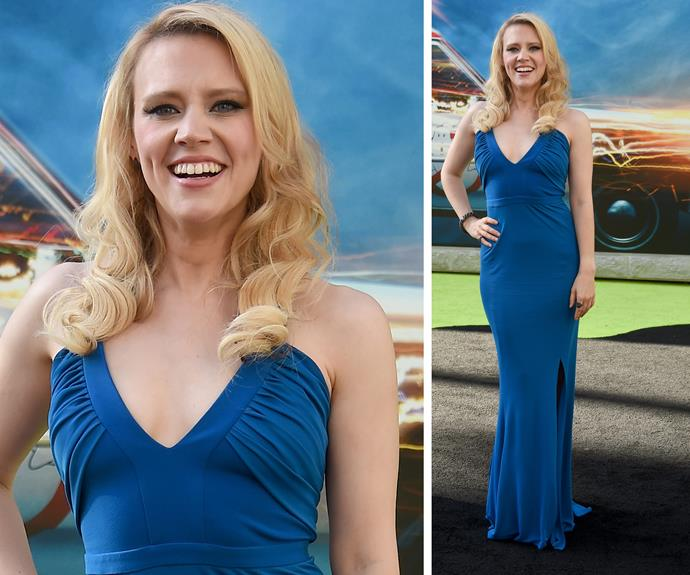 Kate McKinnon looks oh so chic in this plunging blue frock.