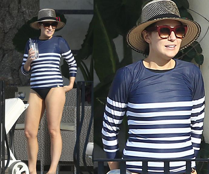 The beauty mogul was sure to keep sun-safe in a stylish striped rashie, oversized sunglasses and a chic boater.