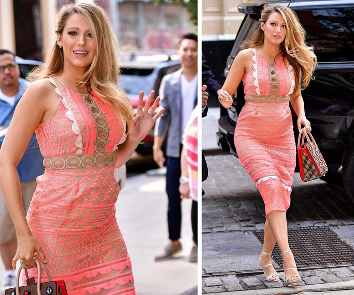 The hot mama is back at it again! Blake is on the promotional tour for her next flick, Woody Allen's film *Cafe Society*. The 28-year-old donned a very pretty lace neon pink dress designed by Jonathan Simkhai. And the only thing sweeter than her growing bump was her stunning lock, pinned to one-side.