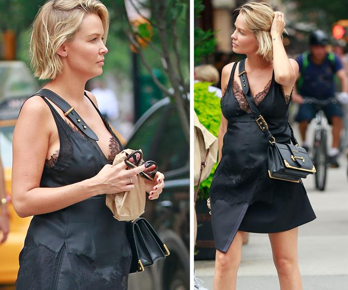 Rocket's mum looked stylish in a black lace sleeveless dress paired with a Prada handbag and suede boots.